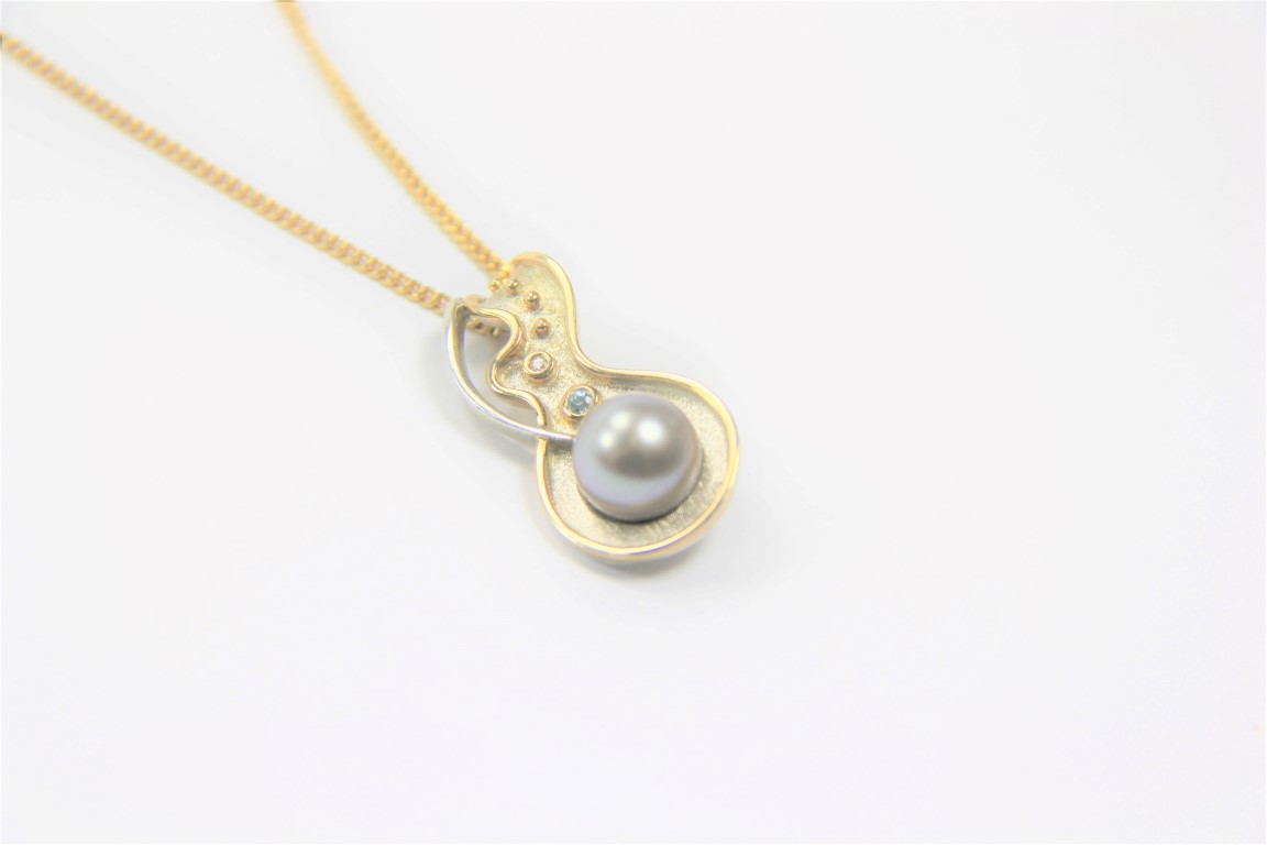 Gold and silver Pearl topaz Pendant
