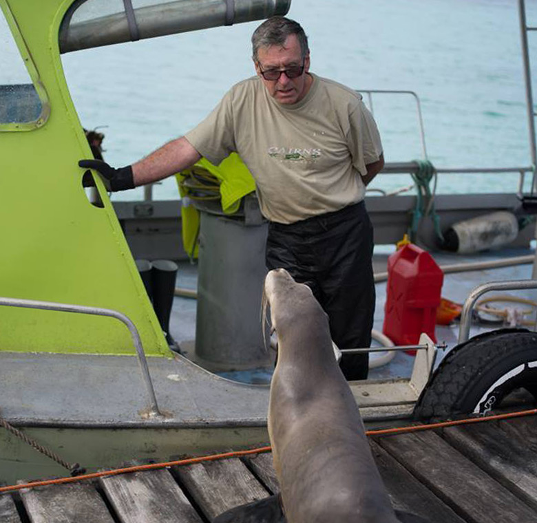 Pearl farmer Barry Humfrey and a seal at their abrolhos island pearl farm